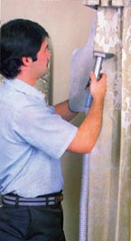 Technician cleaning drapes with Solv-A-Clene