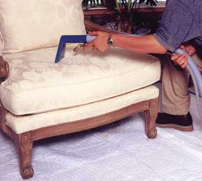 Cleaning chair on quilted furniture pad