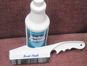 Handi-Brush to remove dog hair from rugs