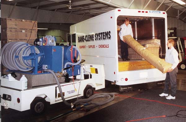 Image of cleaned area rug being loaded into truck to be returned to customer