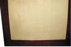 Chenille bound sisal rug